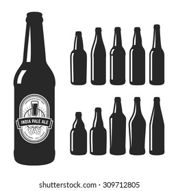 Set of 10 various craft beer bottles. Different shapes and sizes.
