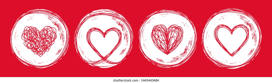 Set of 4 heart tangled grungy scribble in an ink circle hand drawn with brush. Isolated on white background. Vector illustration
