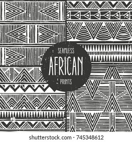 Set of 4 seamless ethnic backgrounds. Monochrome abstract seamless prints in african style. All patterns are available under the clipping mask. EPS10 vector illustration.