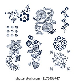 Set of 7 wood block printed floral elements. Traditional dotted ethnic motifs of Russia, indigo blue on white background. For your design of ornamental patterns or borders.