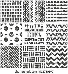Set of 8 primitive geometric patterns. Tribal seamless background. Stylish trendy print. Modern abstract wallpaper with grunge texture. Vector illustration EPS10.