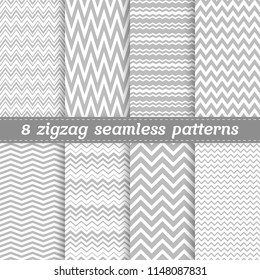 Set of 8 seamless vector patterns with light grey zigzag tracery in flat style