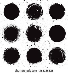 Set of 9 hand drawn grunge background shapes. Isolated ink spots.