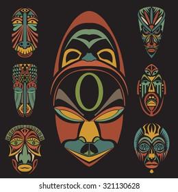 Set of African Ethnic Tribal masks on black background. Flat icons. Ritual symbols.