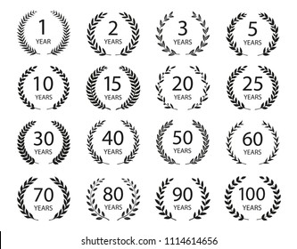 Set of anniversary laurel wreaths. Black and white anniversary symbols isolated on black background. 1,2,3,5,10,15,20,25,30,40,50,60,70,80,90,100 years. Template for award and congratulation design.