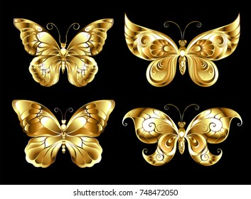 Set of artistic, jewelry, gold butterflies on black background.