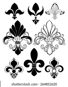 Set of artistically painted, isolated, black Fleur de Lis on white background.
