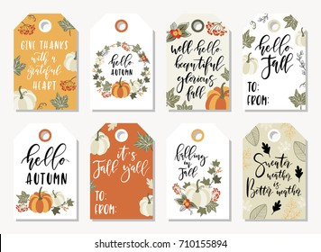 Set of autumnal tags for thanksgiving or seasonal design with pumpkins, lettering and autumn leaves.