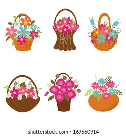 Set of baskets of flowers isolated over white