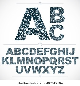 Set of beautiful capital letters decorated with herbal ornament. Black and white vector typescript made in floral style.