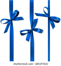 Set of beautiful decorative bows with vertical ribbon for gift decoration. Vector blue bow isolated on white