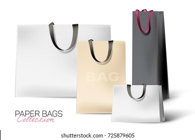 Set of beautiful, realistic shopping bags. Paper texture and silk handles. Different size and colors bags