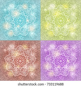 Set of beautiful vector diwali greeting card designs. Creative and artistic mandala tattoo design on light blue background with shining lights and bokeh effect. Glaring Christmas snowflake pattern.
