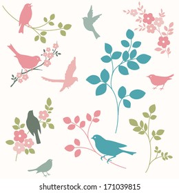 Set of birds and twigs. Decorative tree branches and bird silhouettes