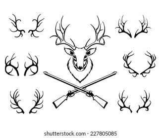 Set of black antlers vector silhouettes with a central trophy and guns in a hunting or deer stalking concept