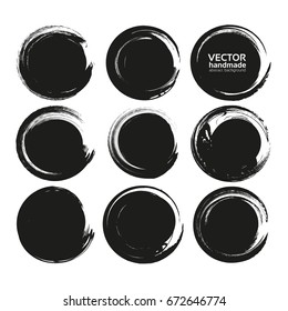 Set of black circle abstract textured smears isolated on a white background