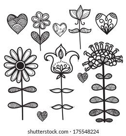 Set of black decorative cartoon flowers isolated on white background