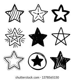 Set of black hand drawn doodle stars in isolated on white background.