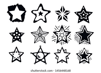 Set of black hand drawn doodle stars. star icon on white background. vector illustration