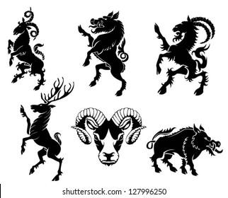 Set of black silhouette on horned animal heraldry element