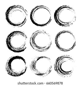 Set of black textured circle strokes  isolated on a white background