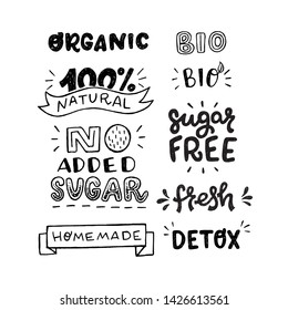 Set of black and white hand drawn inscriptions. Stickers with lettering text Organic, 100% Natural, No Added Sugar, Homemade, Bio, Sugar Free, Fresh and Detox. Healthy food theme messages for labels