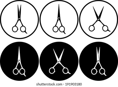 set of black and white scissors in frame