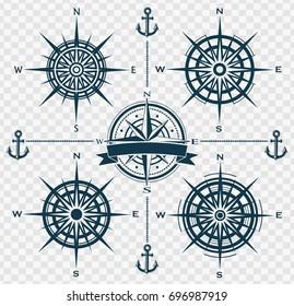 Set of blue compass roses or wind roses on transparent background. Vector illustration.