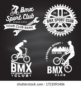 Set of bmx extreme sport club badge on chalkboard. Vector. Concept for shirt, logo with man ride on a sport bicycle. Vintage typography design with bmx cyclist, bmx sprocket and chain silhouette.