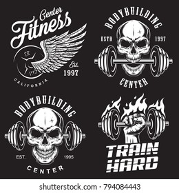 Set of bodybuilding emblems with skull wings and sport equipment in white colour. Vector illustration