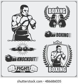 Set of boxing club labels, emblems, badges, icons and design elements. Vintage style. Monochrome illustration.