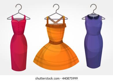 Set of bright dresses on hangers