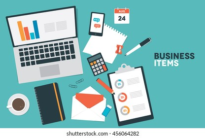 A set of business items including a computer and stationery