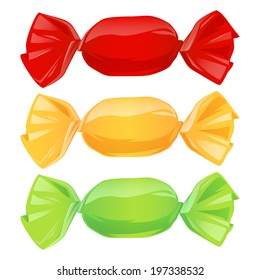 Set of candies in color wrappers - red, yellow, green.