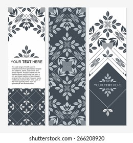 Set of cards with floral elements. Seamless border. Stylized tulip. Egyptian decorative motifs. Vertical banners templates