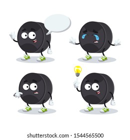 set of cartoon black rubber hockey puck character mascot on white background