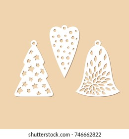 Set carved Christmas decorations. Openwork Christmas tree, heart and bell. Laser cutting vector template.
