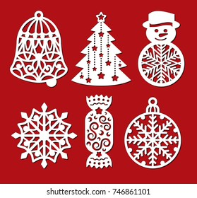 Set of Christmas decoration: bell, xmas tree, snowman, snowflake, candy, ball. Template for laser cutting, wood carving. Vector silhouette on red background. Openwork toy with a lace ornament.
