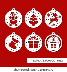 Set of Christmas decorations - balls with a christmas tree, snowman, deer, gift, sock and house.Template for laser cutting, wood carving, paper cut and printing. New Year theme. Vector illustration.