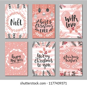 Set of christmas greeting cards with hand written greeting words and floral wreaths and branches and brush strokes on background