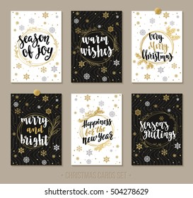 Set Christmas and Happy New Year greeting cards with handwritten brush calligraphy and decorative elements. Decorative vector illustration for winter invitations, cards, posters and flyers.