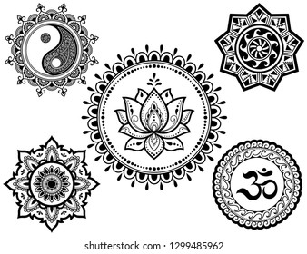 Set of circular patterns in form of Mandala with religious symbols. Oriental signs OM, Yin-Yang, lotus flower, sun for Henna, Mehndi, tattoo, decoration. Decorative ornament in ethnic style.