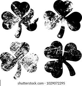 Set Clover leaf isolated black on white background. The effect of abrasion and distressed.