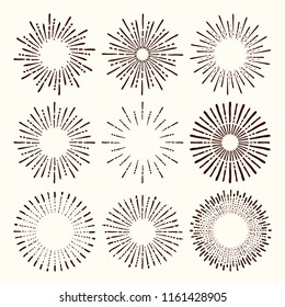 Set and collection of trendy hand drawn retro sunburst/bursting rays design elements.