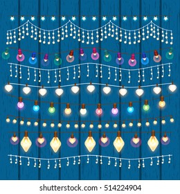 Set of colorful garlands to the New Year holidays and Christmas. Collection of borders on a blue wooden background