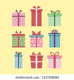 Set of colorful icons of gift boxes. Flat design for Christmas present, love valentine present on yellow background. Vector illustration.