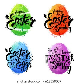 Set of colorful watercolor splashes eggs with Easter greeting hand-lettering. Vector.