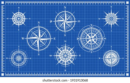 Set of compass roses or wind roses on blueprint background