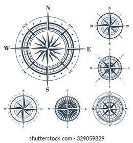 Set of compass roses or windroses isolated on white. Vector illustration.