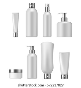 Set of cosmetic packaging with silver caps, isolated on white background. Cosmetic package for cream,  shampoo, liquid soap and spray